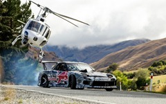 Mazda-RX-7-Red-Bull-drift-car-front-three-quarter-with-helicopter